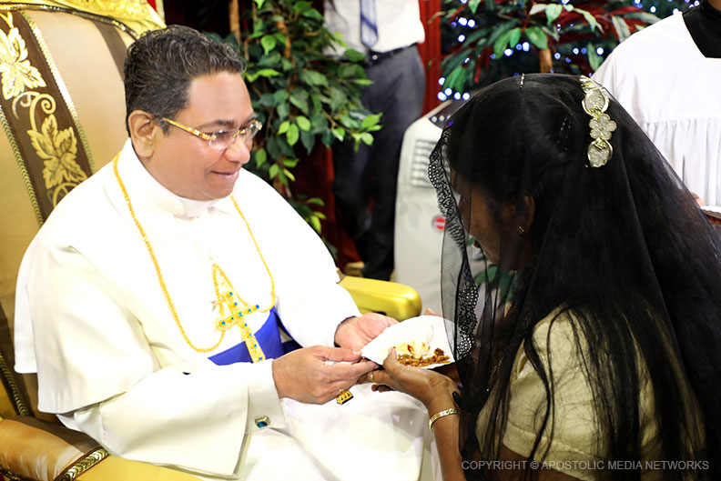 A treat of milk-rice from the sacred hands of His Holiness the Apostle in the New Year