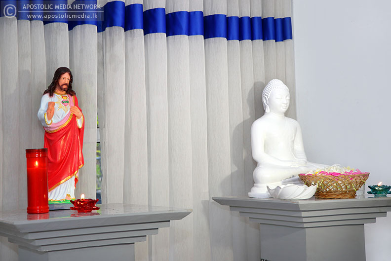His Holiness The Apostolic Father pays homage offering a tray of flowers in front of the statue of Lord Buddha and sets an example how religious reconciliation should prevail